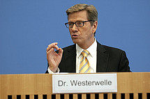 Press conference of Dirk Niebel, Thomas de Maizière and Guido Westerwelle